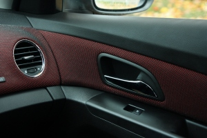 Red fabric inserts in the dash and doors contrasts nicely with the black interior.