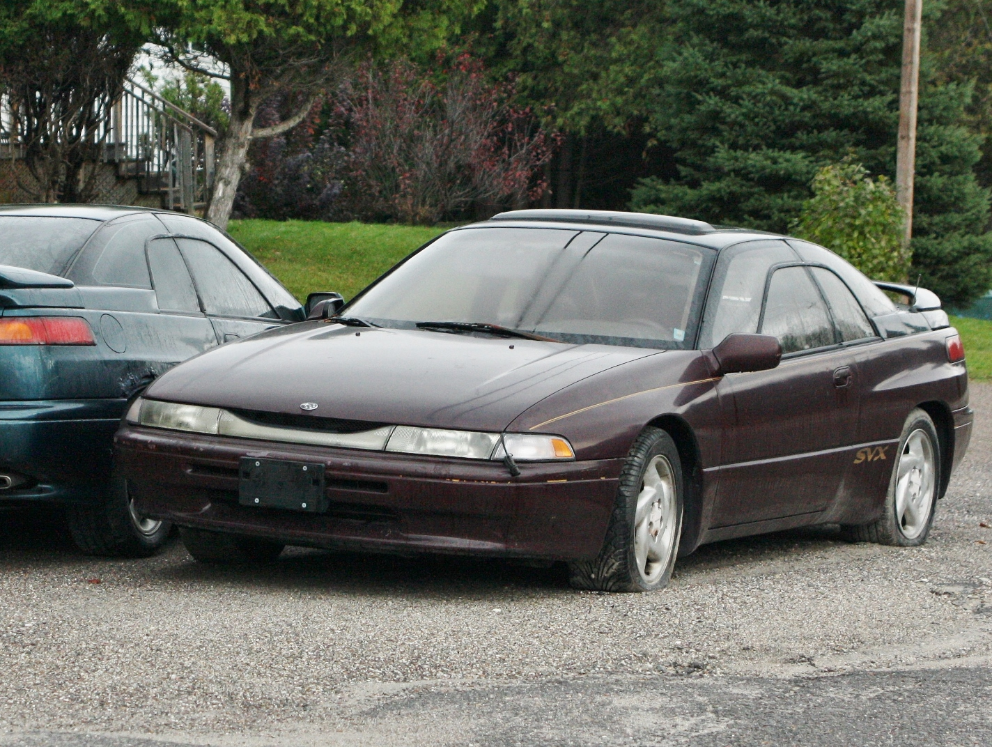 Svx fyi driven to attraction a little closer its tires may be flat but that block heater cord is vanachro Images