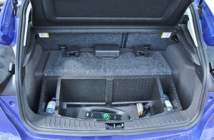 The car's charging plug lies behind the battery hump in the rear hatch.