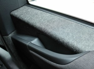 Lightweight carbon fiber-reinforced body panels are found throughout the interior.