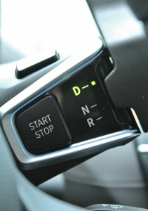 Shifty: a steering column-mounted gearshift uses a button to actuate 'Park'.